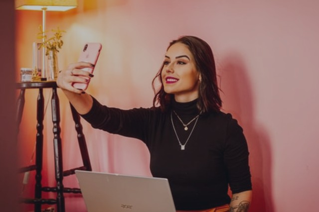 influencer women taking a selfie with her smartphone